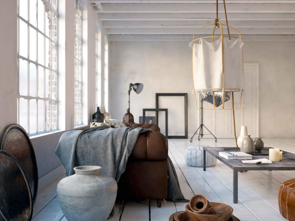 Bauen mit Lehm: Loft mit Holzdielen, Lehmwänden und Ledersofa.