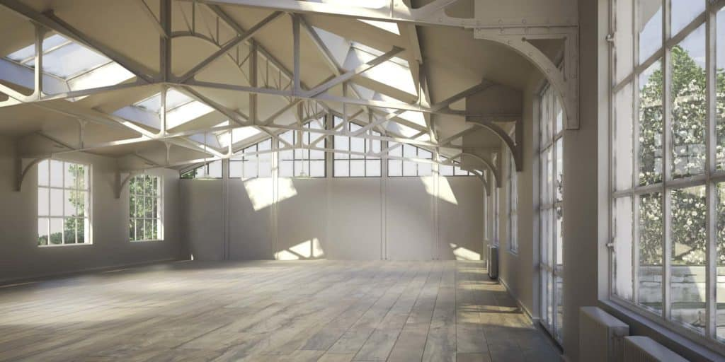Zum Loft sanierte Farbrikhalle mit grauem Holzboden, riesigen Fenstern und Metallträgern in der Decke.