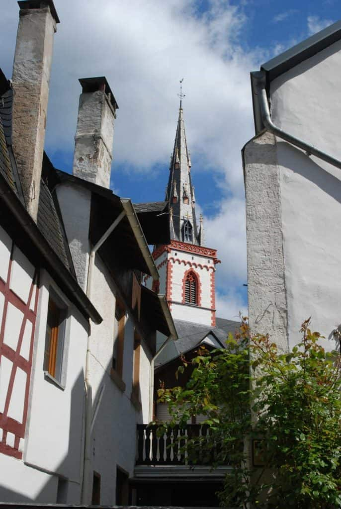 old historic church spire and houses in Ediger Germany (Spontanurlaub)